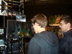 Alexander Ringe of COmplexity Games in New York plays Bionic Commando for the first time as friends watch on.