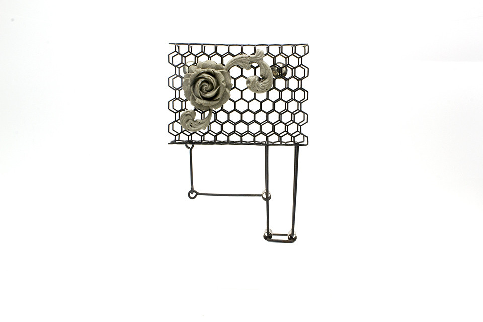 Steel and Cement Kinetic Brooch by Erin Cora Turner.