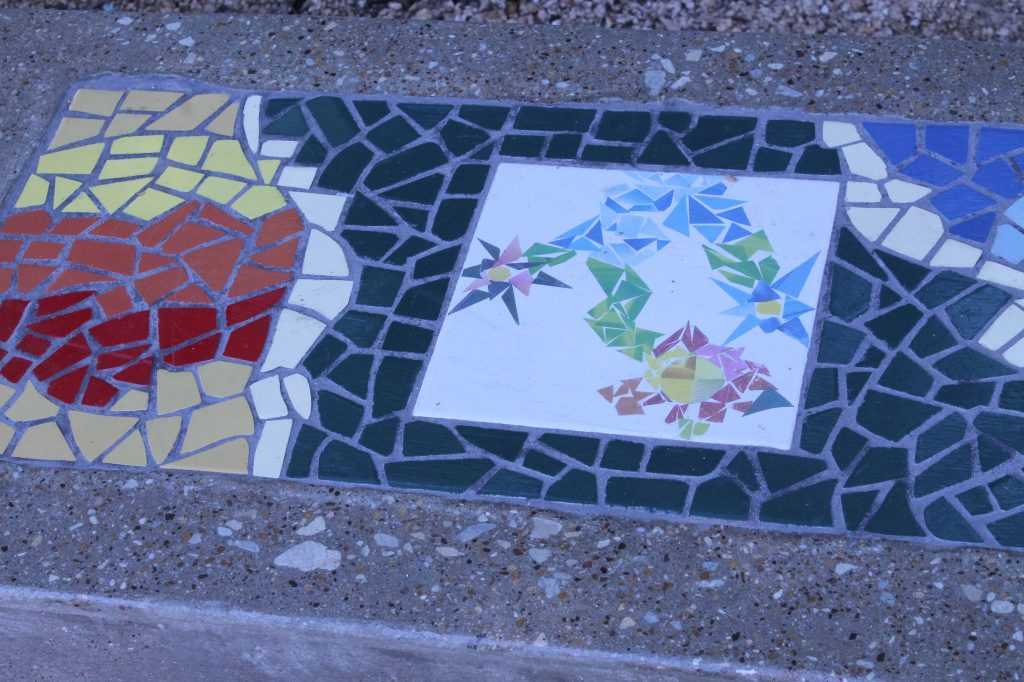 The mosaics on the bench illustrate the seasons: this is spring, and the three flowers represent the three forks of the Trinity River. Photo: Francesca Paris