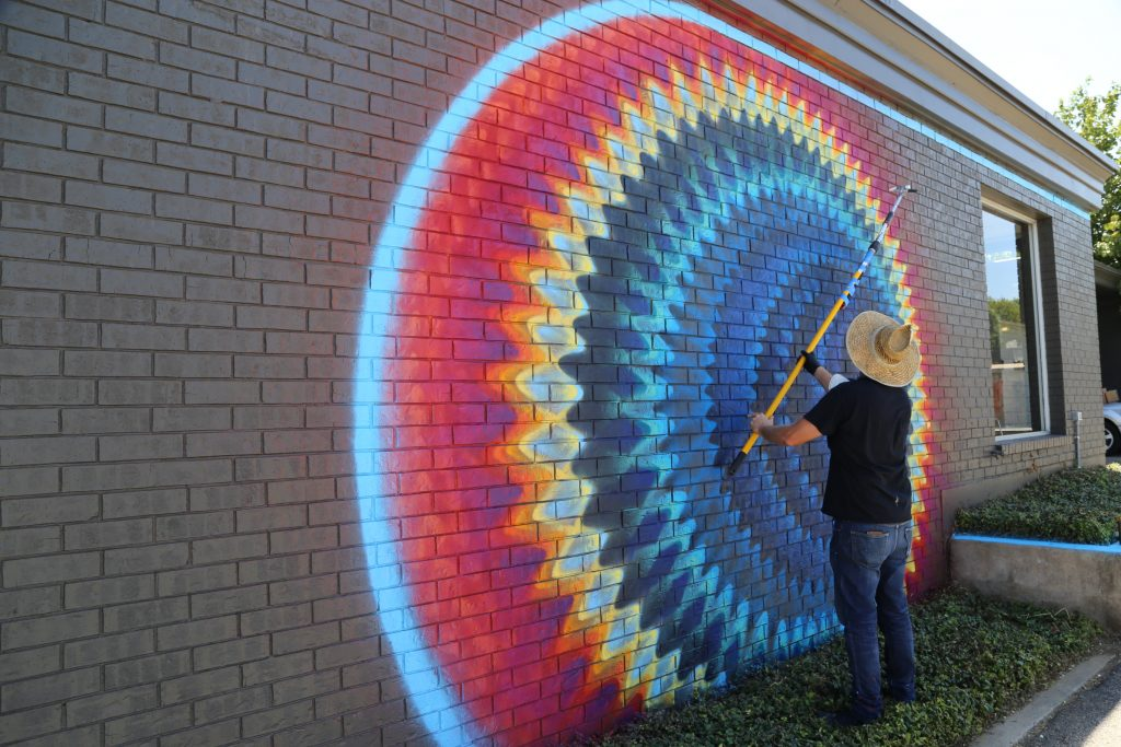 Miami artist Douglas Hoekzema painting a mural in front of Fort Works Art. Photo: Hady Mawajdeh