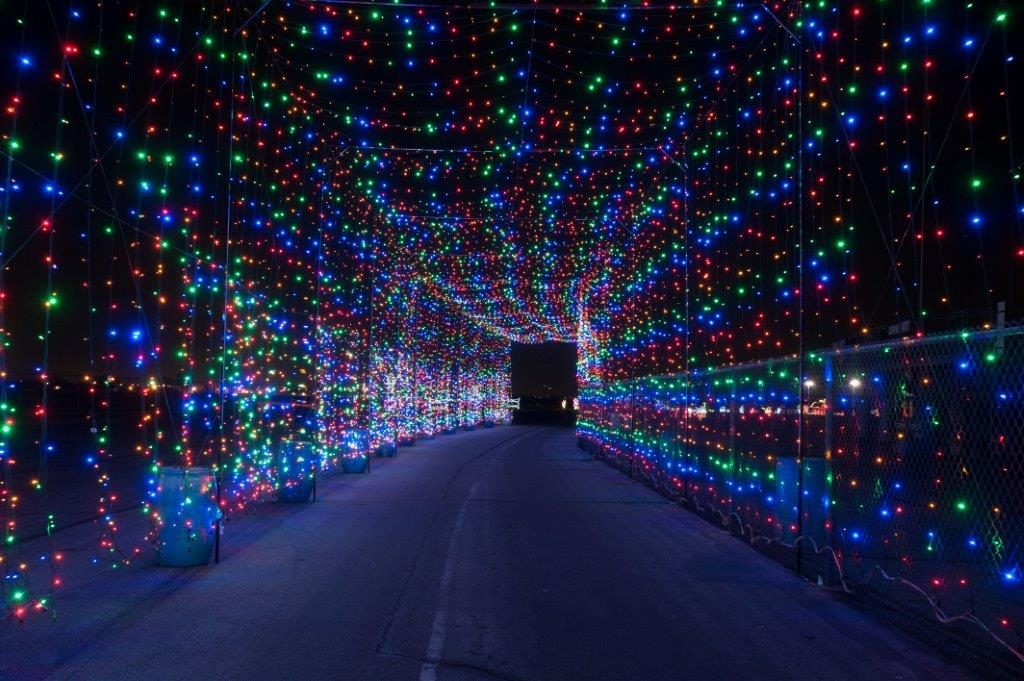 A tunnel of colored lights is just one of the many displays at Gift of Lights. Photo: Gift of Lights at Texas Motor Speedway