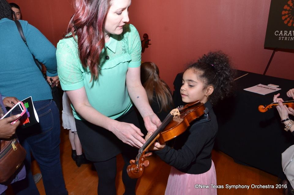 """Try on the violin for size at an instrument """"petting zoo."""" Photo: New Texas Symphony Orchestra"""