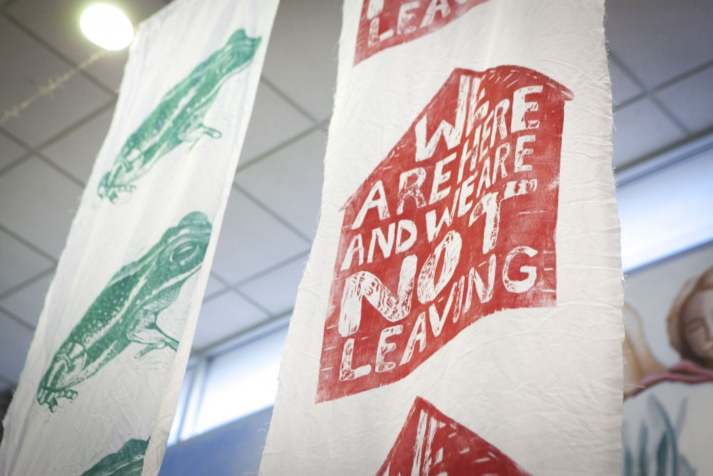 """This is one of Faz's banners with phrases like, """"We are here and we are not leaving."""""""
